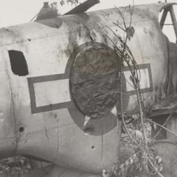 Wrecked US plane w/ covered...