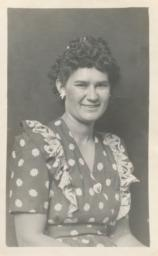[A Woman in a Daisy-covered Dress and Matching Earrings]