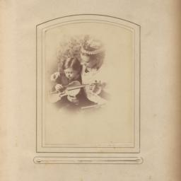 Woman and Young Boy Holding...
