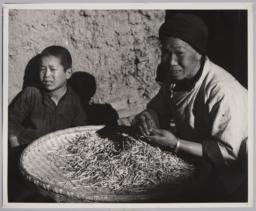 Woman With Woven Bowl