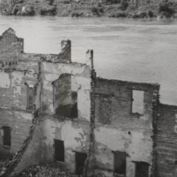 Burned Buildings By River L...