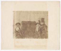 Two Women and a Man by a Portrait