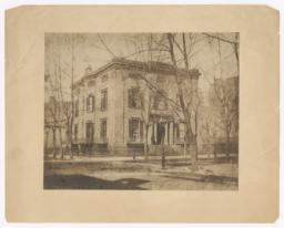 "De Rham House at 5th Ave. and 10th St. ""Now Standing"""