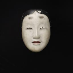 Small Mask Of Young Woman
