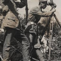 Chinese Men Surveying With ...