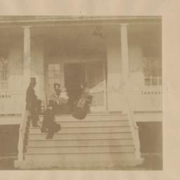 Four People and Baby on Porch