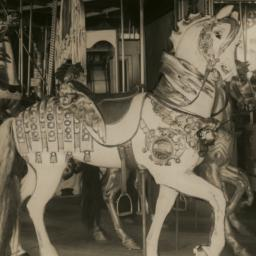 Carousel, with horse carved...