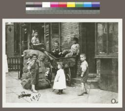 Children with Burlap Sacks and Wheelbarrow