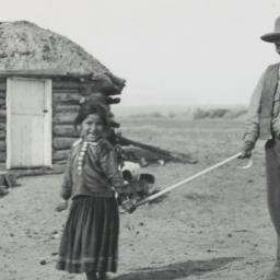 Young Navajo Girl Guiding a...