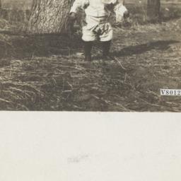 Young Boy near an Oak Tree