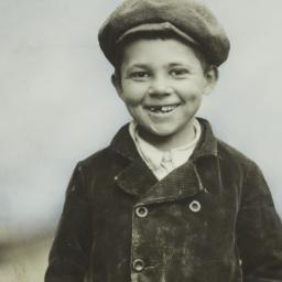 Boy in Cap with Front Teeth...