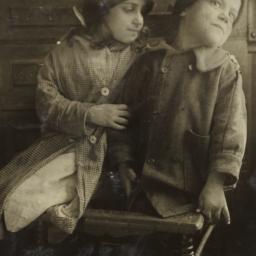 Two Children on Broken Chair