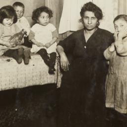 Woman with Four Children ne...