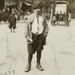 Boy Holding Wood Scrap