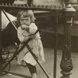 Girl Leaning on Wrought Iro...