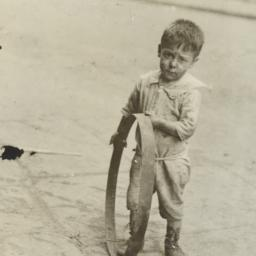 Boy with Metal Circle