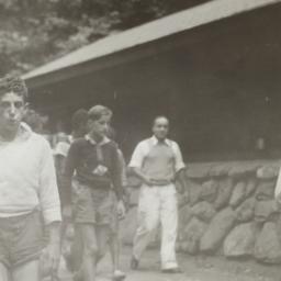 Boys Walking near Cabin