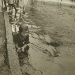 Child in Water near Curb