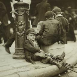 Crippled Boy Resting Agains...