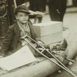 Boy with Crutches Resting A...