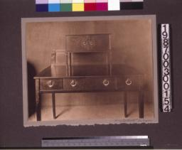 Rosewood writing desk designed by Charles Green.