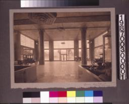 View toward street, showing built-in furniture, decorative light fixtures, and tile-covered columns.