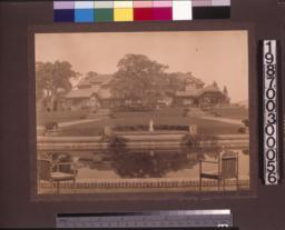 South (rear) elevation of the main residence with pool and formal garden.