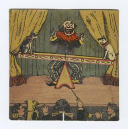 Clown With Two Dogs On See-saw Pantin