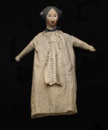 Female Hand Puppet With Blue Ribbon Around Neck