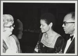 Barbara and Ulysses Kay talking with woman